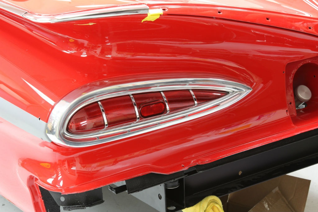 The Impala's winky-eye tail lamps have been restored and are fitted with Classic Industries gaskets, lenses, and trim.