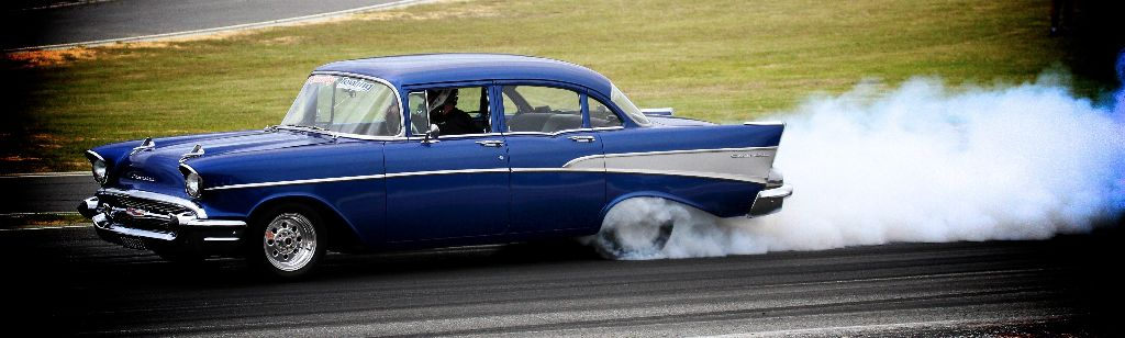 Bec's husband, Brent, putting pedal to the metal in the Bel Air.